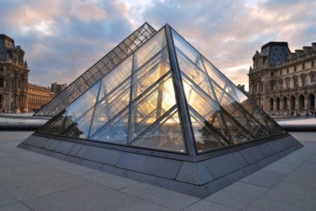 14581656-paris-the-glass-pyramids-in-the-napoleon-courtyard-of-the-louvre