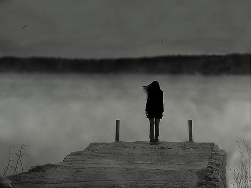 lonely woman on dock