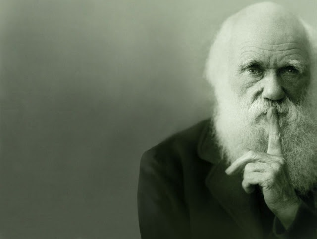 Charles Darwin asking for quiet.